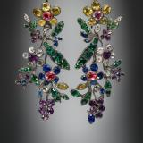 A pair of floral earrings with multicolored stones