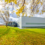 fall foliage surrounds a white Contemporary Art + Design Wing