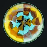 Turquoise, red and orange glass in a circular shape