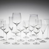 15 clear glass goblets in varying sizes and shapes