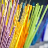 A row of colored glass rods, creating a rainbow