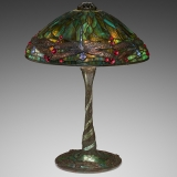 an ornate lamp with a stained glass cover featuring a large dragonfly