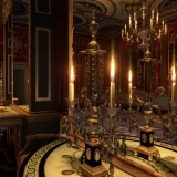 A virtual reality view of an ornate room with a gold candle holders, mirrors, and a door in the back.